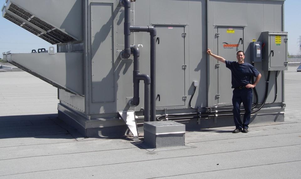 Centrale de compensation d'air avec serpentins de récupération de chaleur